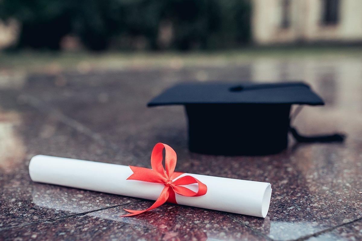 Graduation diploma and hat